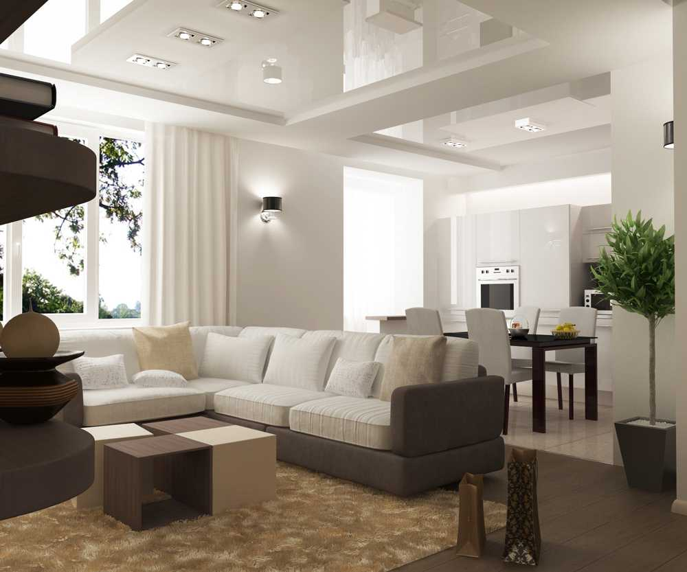 Для маленькой гостиной можно создать зонирование между кухней и залом