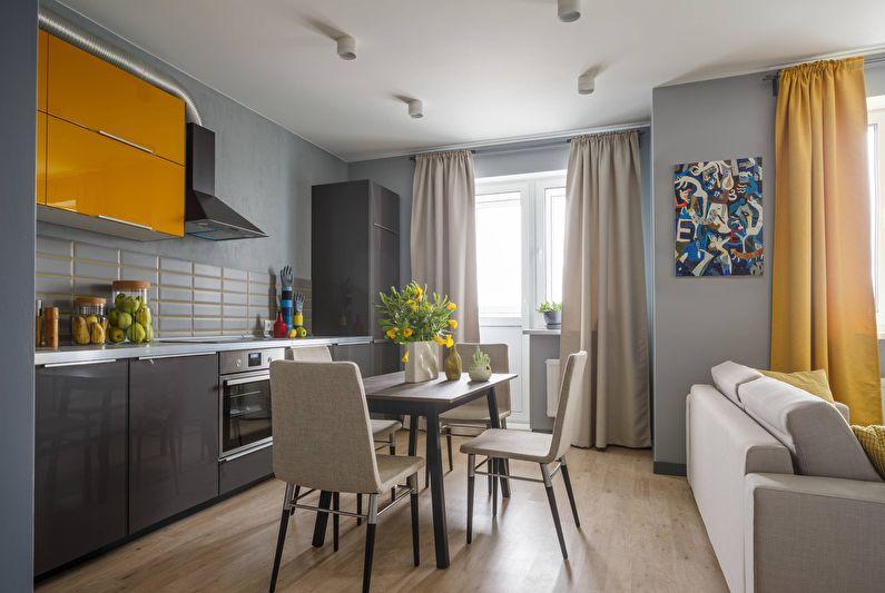 Дизайн интерьера кухни-гостиной в сером цвете - фото