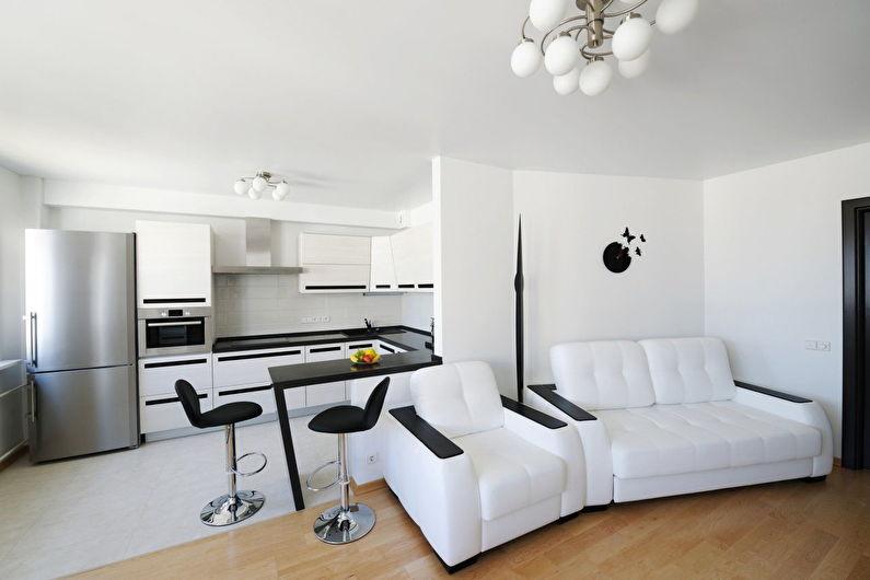 Дизайн интерьера белой кухни-гостиной - фото